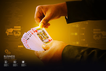 Businessman showing playing cards
