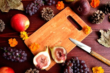 Autumn fruits and cutting board