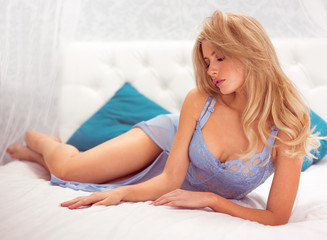 sexy blonde woman wearing blue lingerie