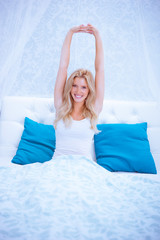 attractive woman stretching in the morning and is smiling