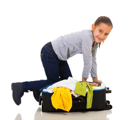 girl packing suitcase