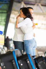 loving couple hugging before parting at airport
