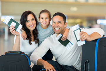 family holding boarding pass and passport
