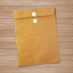 Envelope documents on vintage wood