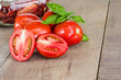 Fresh red paste tomatoes with jar
