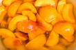 Bowl of fresh sliced peaches in syrup