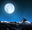 Matterhorn in night sky with moon