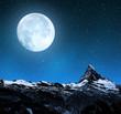 Matterhorn in night sky with moon