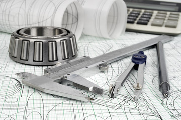 roller bearing, vernier callipers , compasses and drawings .