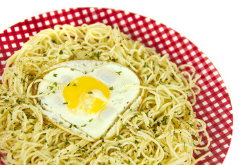 heart shaped fried egg on noodles