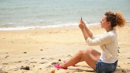Girl Taking Photo with Tablet on the Beach.