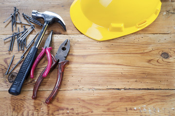 hammer, nails , nippers and yellow helmet