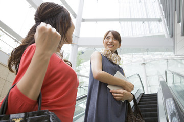 Women who are in the escalator