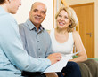 mature couple listening agent with paper - 68513653
