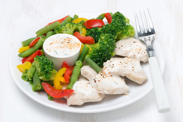healthy food - chicken, steamed vegetables and yoghurt sauce