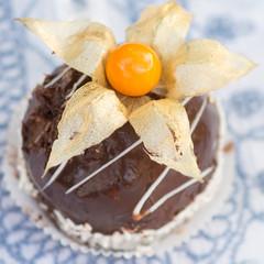 Closeup of cake with physalis