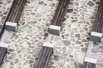 Wooden benches on stone pavement