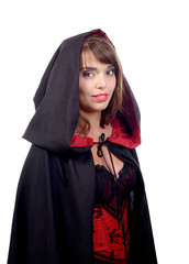 pretty girl dressed in a black cape for halloween