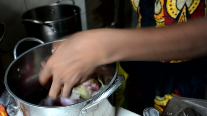 woman peels the onion