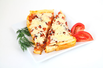 Italian lasagna with decoration on white plate