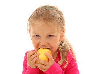 Little girl bites in an apple
