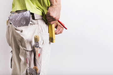 Man with masonry and painting tools
