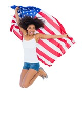Pretty girl wrapped in american flag