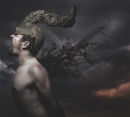 scared, man with golden helmet horns concept nightmares
