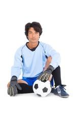 Goalkeeper in blue holding ball