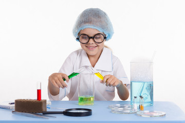 Young chemist in glasses posing experience