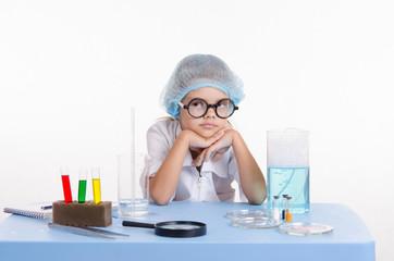 Girl bored chemist