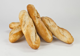six baguettes on a white background