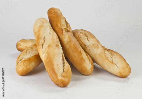 Plexiglas Brood six baguettes on a white background