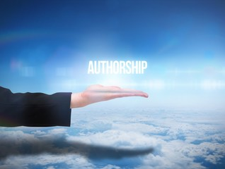 Businesswomans hand presenting the word authorship