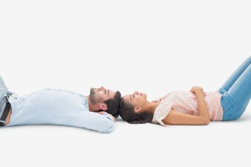 Attractive young couple lying down