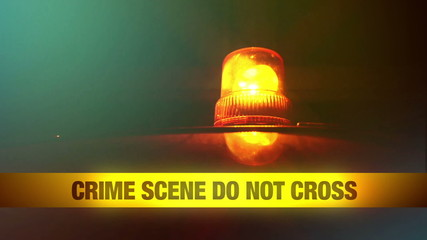 Crime Scene Do Not Cross Yellow Tape and Orange Flashing Light