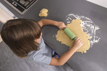 Little girl making cookie dough