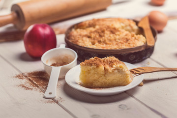 Close up of pie apple with cinnamon on wooden desk