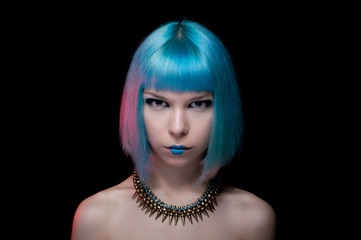 Portrait of young female. Blue hairstyle. Hair coloring.