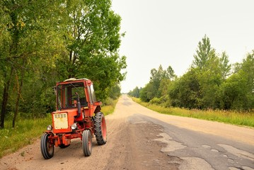 Old Russian tractor on gravel road