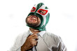stress, aggressive businessman with Mexican warrior mask