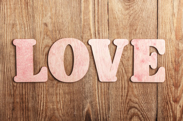 Wooden letters forming words LOVE