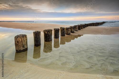 Zdjęcia na płótnie, fototapety na wymiar, obrazy na ścianę : Wschód słońca na plaży