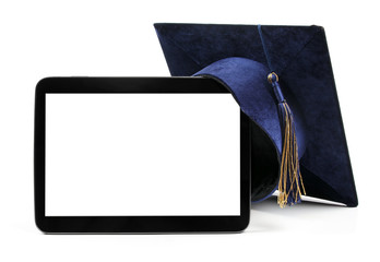 blank digital tablet and education student cap