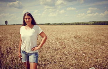 Happy young Woman In Wheat field