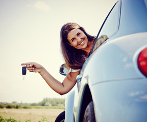 Happy Young car woman showing car keys