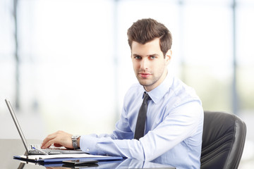 Modern young businessman at office