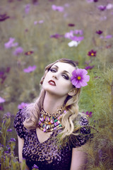 Beautiful woman in flower field