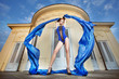 woman dancing with blue fabric