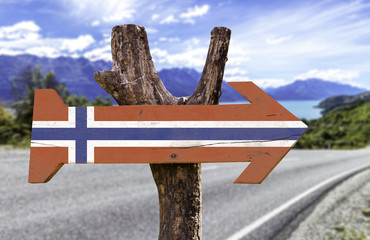 Norway wooden sign with a island on background
